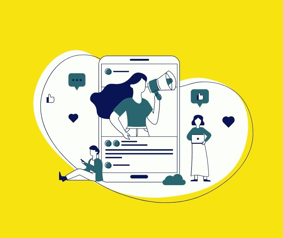 An illustration of a mobile phone with a person in the screen holding up a megaphone. There is a person on their phone and leaning against the main image. Another person, is standing next to it holding a laptop. There are social media icons surrounding the image: heart, thumbs up and a message icon.